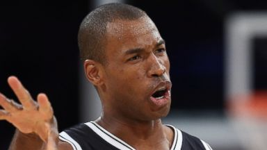 PHOTO: Jason Collins of the Brooklyn Nets gestures against the Los Angeles Lakers at Staples Center, Feb. 23, 2014 in Los Angeles, Calif.