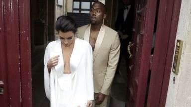 PHOTO: Kim Kardashian and Kanye West leave their residence in Paris, May 23, 2014, ahead of their wedding.