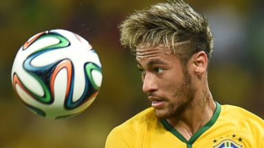 PHOTO: Brazils forward Neymar eyes the ball during the quarter-final match between Brazil and Colombia during the 2014 FIFA World Cup in Fortaleza, Brazil on July 4, 2014.