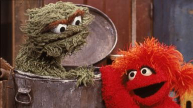 PHOTO: Oscar the Grouch gets a visit from a red muppet
