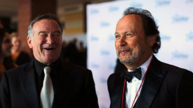 """PHOTO: Comedians Robin Williams and Billy Crystal talk with reporters on the red carpet before the 2012 Starkey Hearing Foundations """"So the World May Hear Awards Gala, in this file photo Aug. 4, 2012 in St. Paul, Minn."""