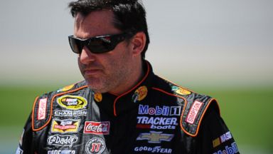 PHOTO: Tony Stewart stands on the grid during qualifying for the NASCAR Sprint Cup Series Aarons 499 at Talladega Superspeedway in Talladega, Alabama, May 3, 2014.