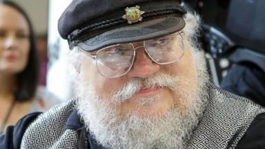 "PHOTO: Writer George R.R. Martin of ""Game of Thrones"" signs autographs during the 2014 Comic-Con International Convention-Day July 25, 2014, in San Diego, Calif."