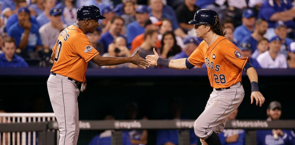 PHOTO: Houston Astros Colby Rasmus celebrates with third base coach Gary Pettis, left, after hitting a home run during the eighth inning in Game 1 of the American League Division Series against the Kansas City Royals, Oct. 8, 2015, in Kansas City, Mo.