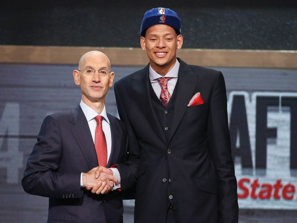 PHOTO: Baylor center Isaiah Austin, right, poses for a photo with NBA Commissioner Adam Silver after being granted a ceremonial first round pick during the 2014 NBA draft, June 26, 2014, in New York.