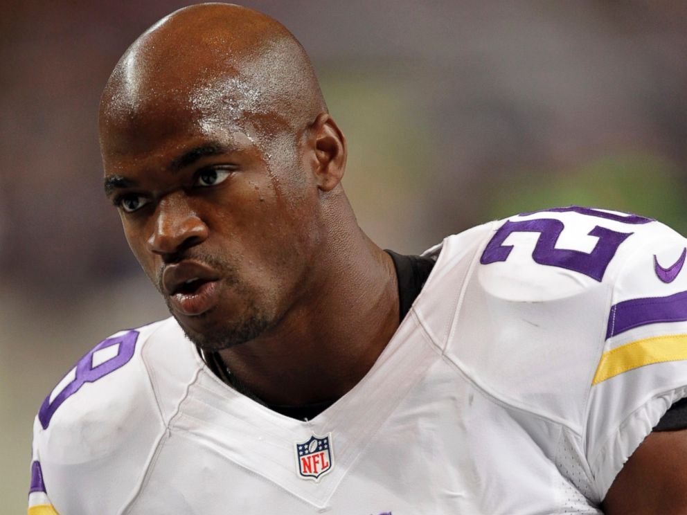 PHOTO: Minnesota Vikings running back Adrian Peterson warms up for an NFL football game against the St. Louis Rams in St. Louis, in this Sept. 7, 2014 file photo.