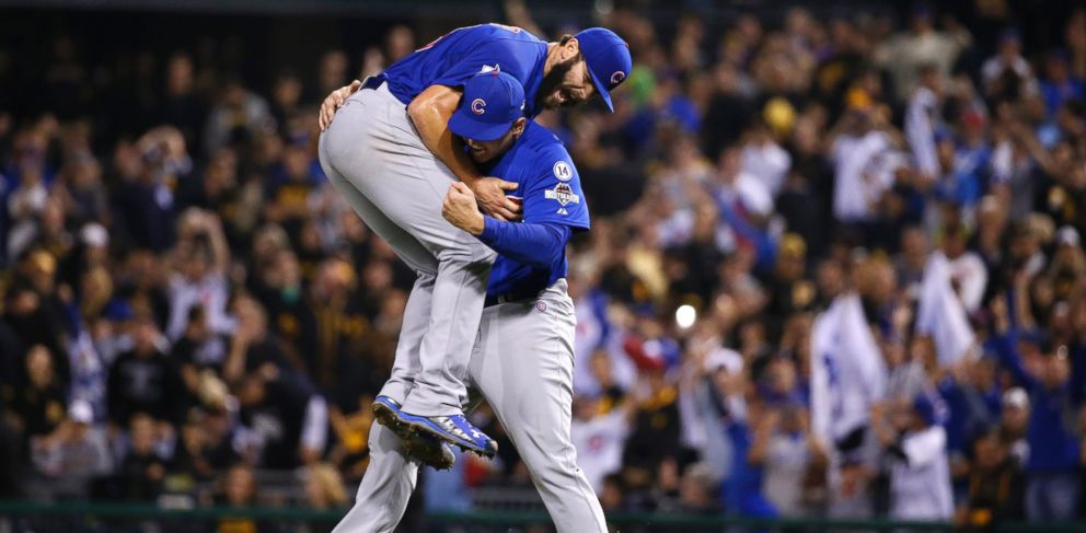 PHOTO: Chicago Cubs first baseman Anthony Rizzo, right, holds Chicago Cubs starting pitcher Jake Arrieta after they defeated the Pittsburgh Pirates in the National League wild card baseball game 4-0, Oct. 7, 2015, in Pittsburgh.