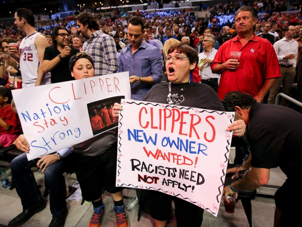 PHOTO: Fans hold up signs in support of the Los Angeles Clippers before Game 5 of an opening-round NBA basketball playoff series between the Clippers and the Golden State Warriors, Tuesday, April 29, 2014, in Los Angeles.