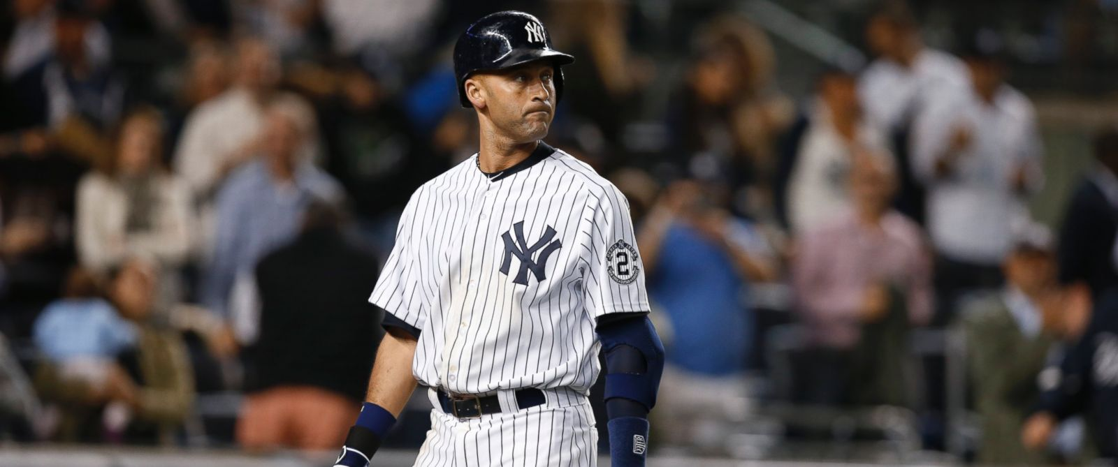 PHOTO: New York Yankees Derek Jeter reacts after striking out with Brett Gardner on first base in the ninth inning of the Yankees 5-4 loss to the Baltimore Orioles in a baseball game at Yankee Stadium in New York, Sept. 23, 2014.