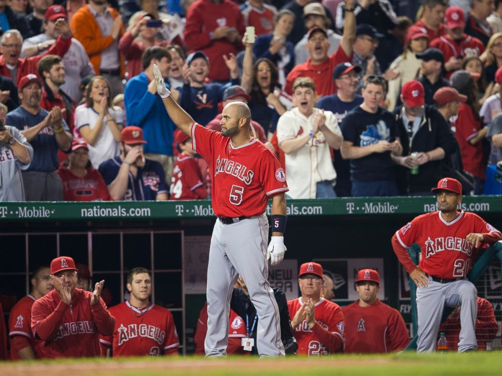 PHOTO: Los Angeles Angels first baseman Albert Pujols acknowledges the applause from the crowd after hitting his 500th career home run, April 22, 2014.