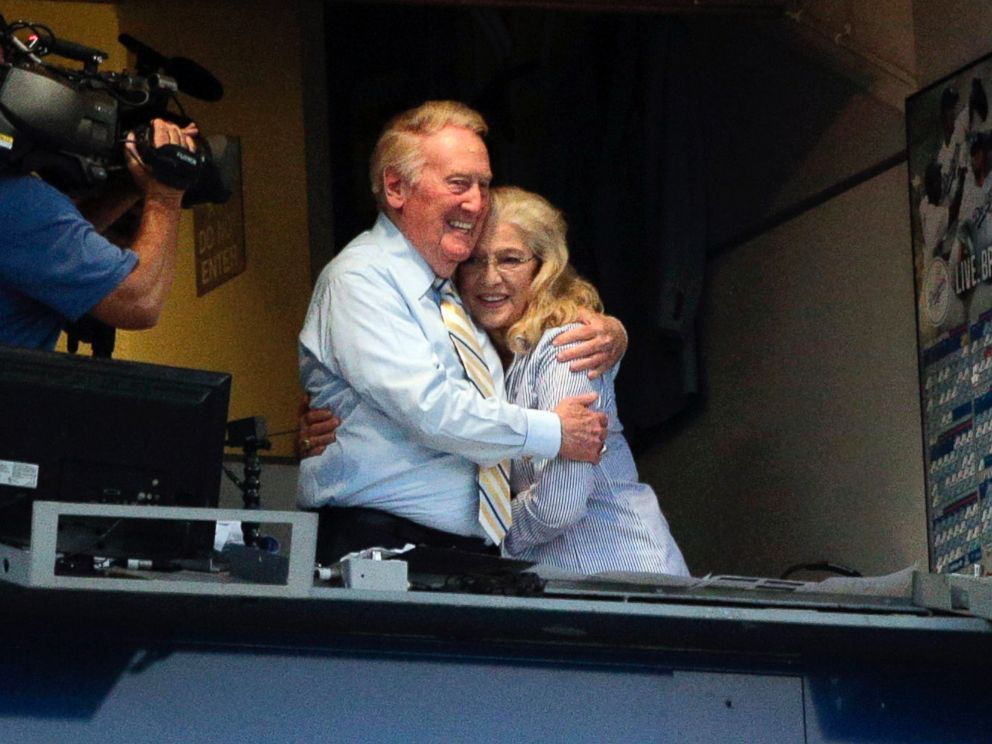 PHOTO: Broadcaster Vin Scully, left, embraces his wife, Sandra, after his 2015 return was announced, July 29, 2014, in Los Angeles.