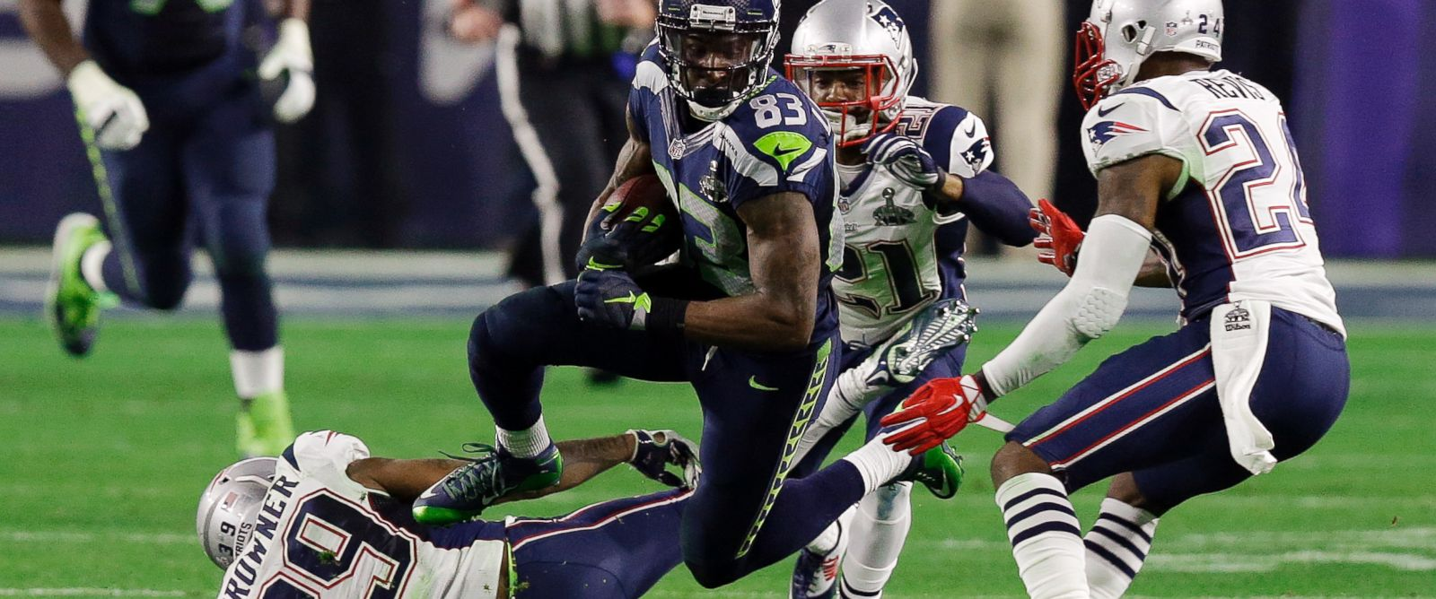 PHOTO: Seattle Seahawks wide receiver Ricardo Lockette leaps over New England Patriots wide receiver Greg Orton during the second half of NFL Super Bowl XLIX football game, Feb. 1, 2015, in Glendale, Ariz.