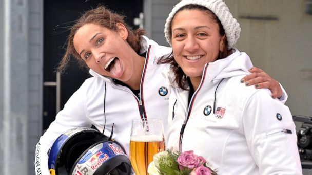 PHOTO: Lolo Jones and Elana Meyers pose for photographers after their second place in the womens Bobsled World Cup race in Winterberg, Germany, Jan. 5, 2014.
