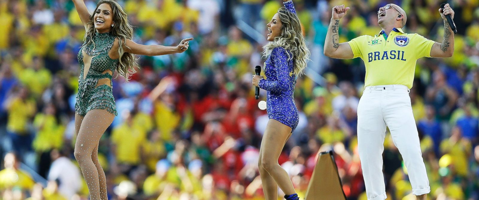 PHOTO:US singer Jennifer Lopez, left, rapper Pitbull and Brazilian singer Claudia Leitte perform during the opening ceremony in the Itaquerao Stadium in Sao Paulo, Brazil, June 12, 2014.