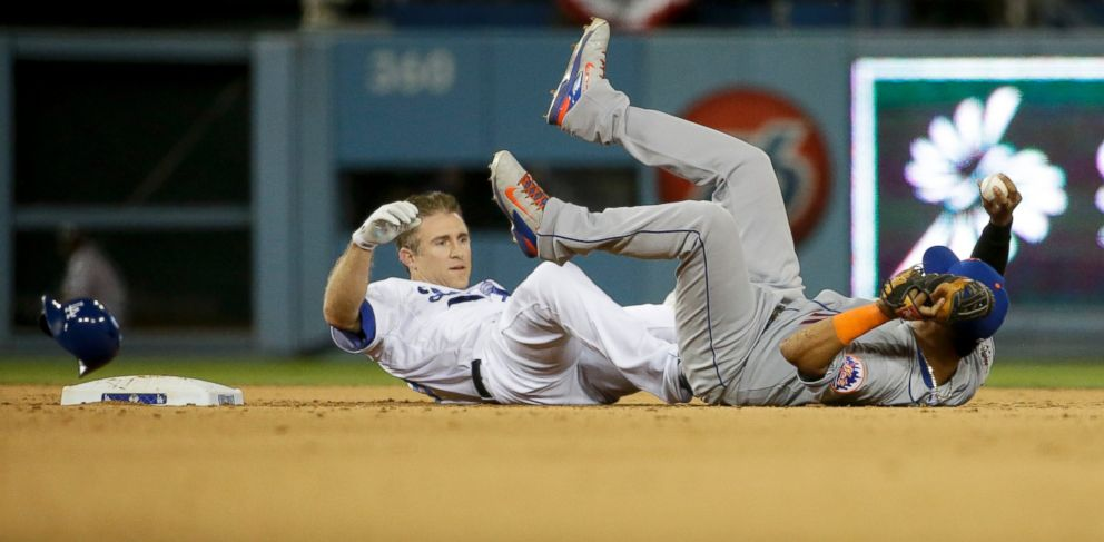 PHOTO: New York Mets shortstop Ruben Tejada, right, lands next to Los Angeles Dodgers Chase Utley who broke up a double play during the seventh inning in Game 2 of baseballs National League Division Series on Oct. 10, 2015 in Los Angeles.