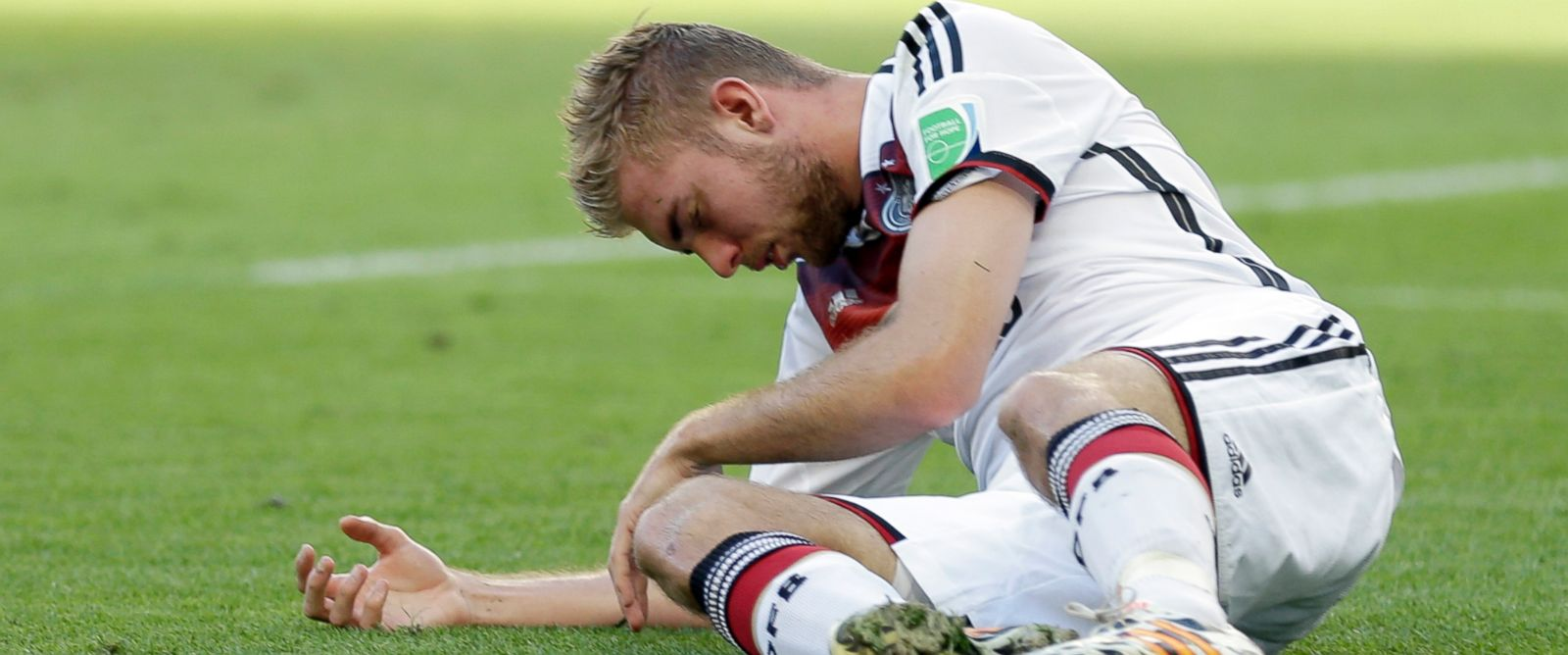 PHOTO: Germanys Christoph Kramer lies on the pitch after getting hit in the face by Argentinas Ezequiel Garays shoulder during the World Cup final soccer match between Germany and Argentina at the Maracana Stadium in Rio de Janeiro, July 13, 2014.