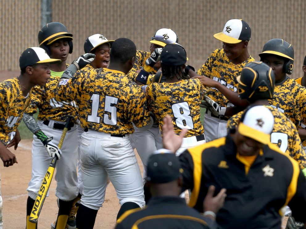 PHOTO: Jackie Robinson West Little Leaguers from Chicago celebrate their win over New Albany, Ind., in the Little League Central Regional baseball championship game in Lawrence, Ind., Aug. 9, 2014.