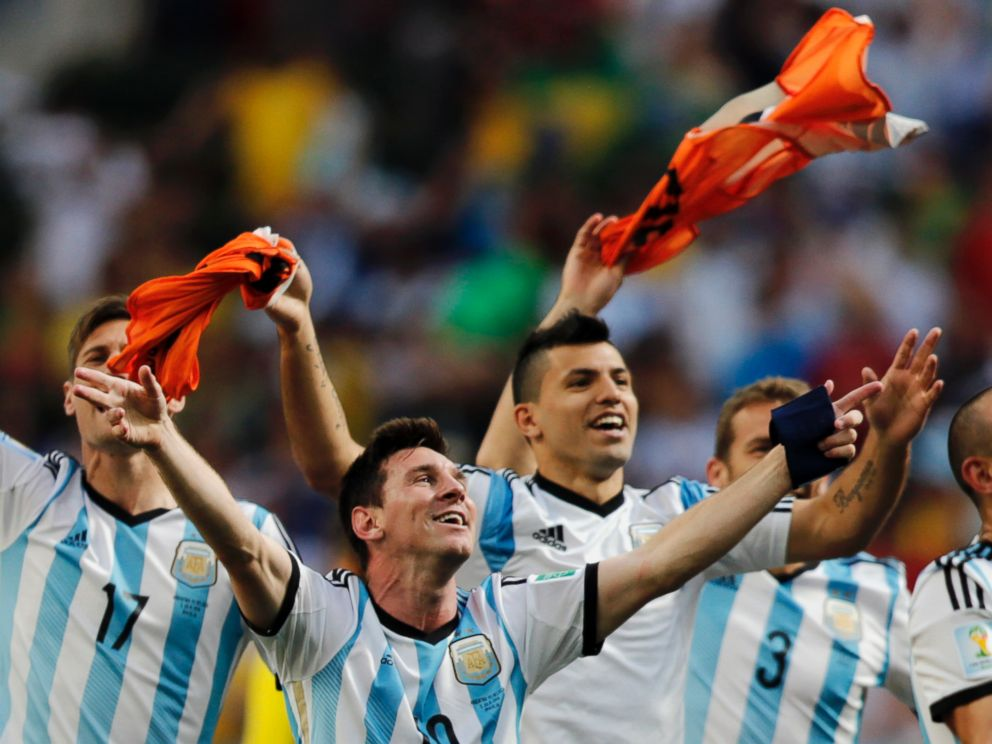 PHOTO: Argentinas Lionel Messi and teammates celebrate at the end of the World Cup quarterfinal soccer match between Argentina and Belgium at the Estadio Nacional in Brasilia, Brazil, July 5, 2014.