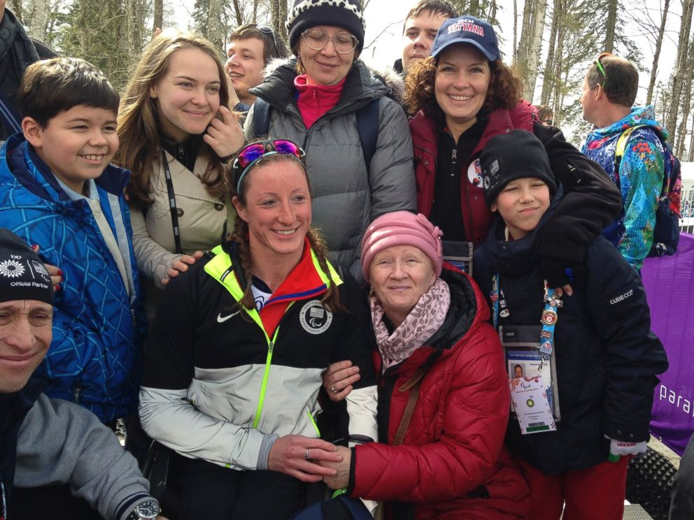 PHOTO: Tatyana Mcfadden poses with her Russian birth mother, second right in the first row, after her race during the ladies 12km cross country ski, sitting event at the 2014 Winter Paralympic, March 9, 2014, in Krasnaya Polyana, Russia.
