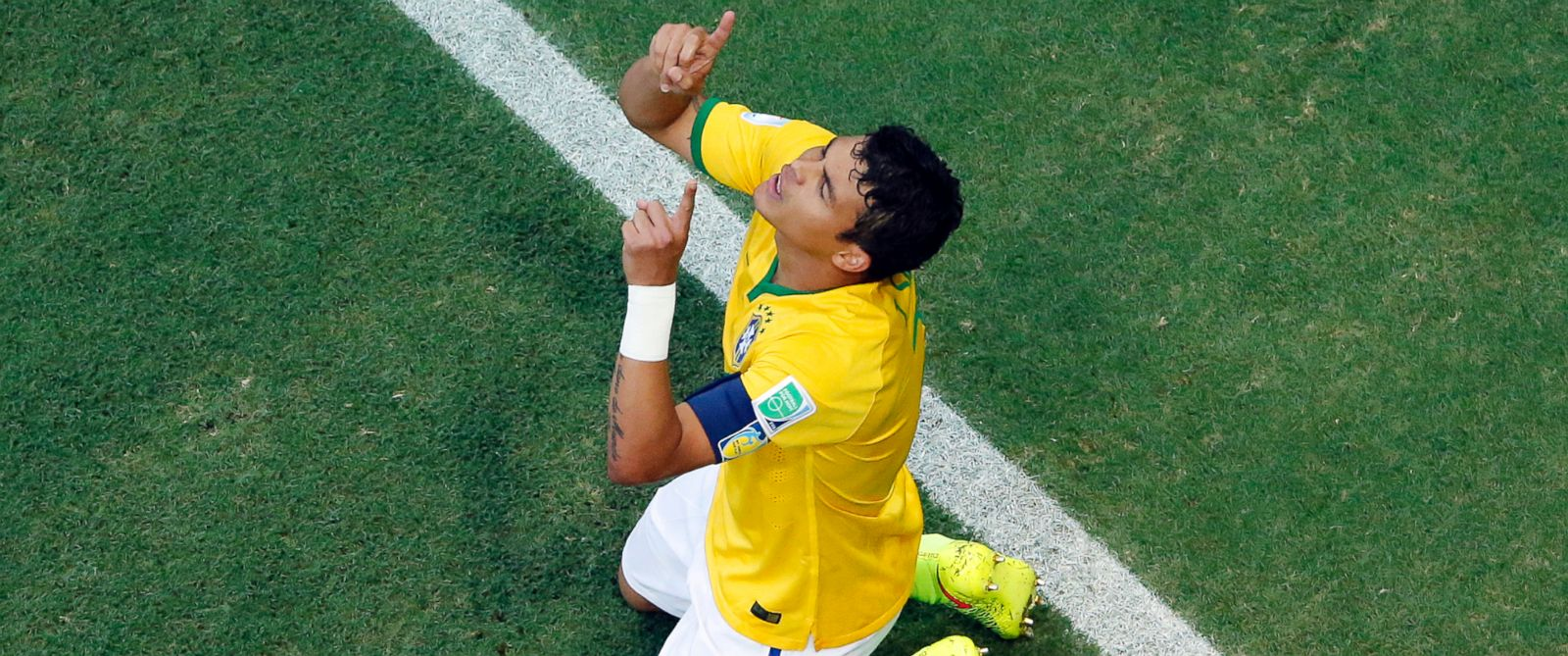 PHOTO: Brazils Thiago Silva celebrates after scoring his sides first goal during the World Cup quarterfinal soccer match between Brazil and Colombia at the Arena Castelao in Fortaleza, Brazil, July 4, 2014.
