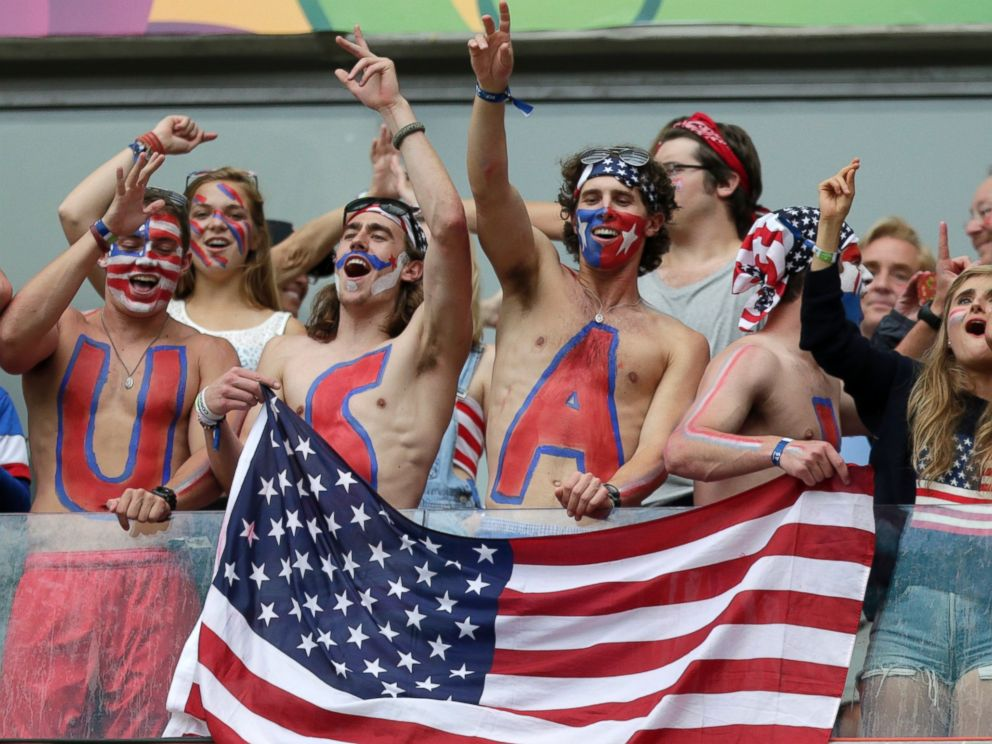 PHOTO: USA fans celebrate after team USA qualifying for the next World Cup round at the Arena Pernambuco in Recife, Brazil, June 26, 2014.