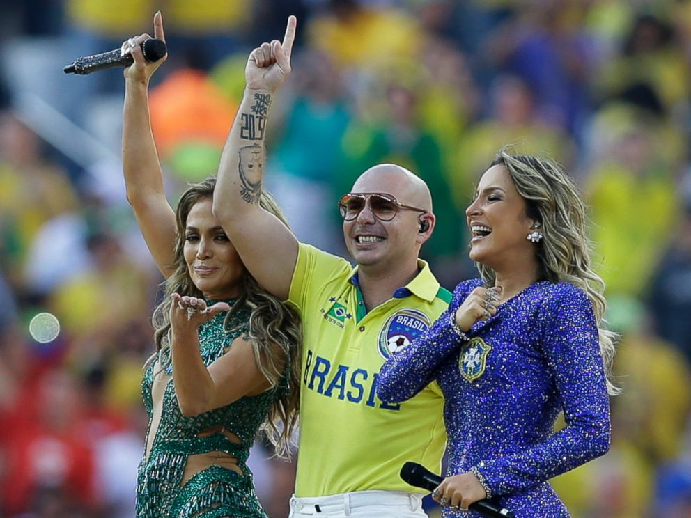 PHOTO: US singer Jennifer Lopez, left, rapper Pitbull and Brazilian singer Claudia Leitte perform during the opening ceremony in the Itaquerao Stadium in Sao Paulo, Brazil, June 12, 2014.