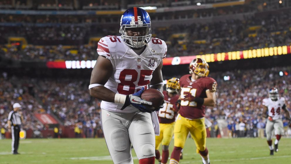 PHOTO: Tight end Daniel Fells #85 of the New York Giants scores a 3rd quarter touchdown at FedExField on Sept. 25, 2014 in Landover, Md.