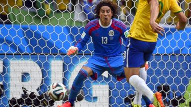 PHOTO: Brazils forward Fred (R) kicks the ball in front of Mexicos goalkeeper Guillermo Ochoa (L) during a Group A football match between Brazil and Mexico in the Castelao Stadium in Fortaleza during the 2014 FIFA World Cup on June 17, 2014.