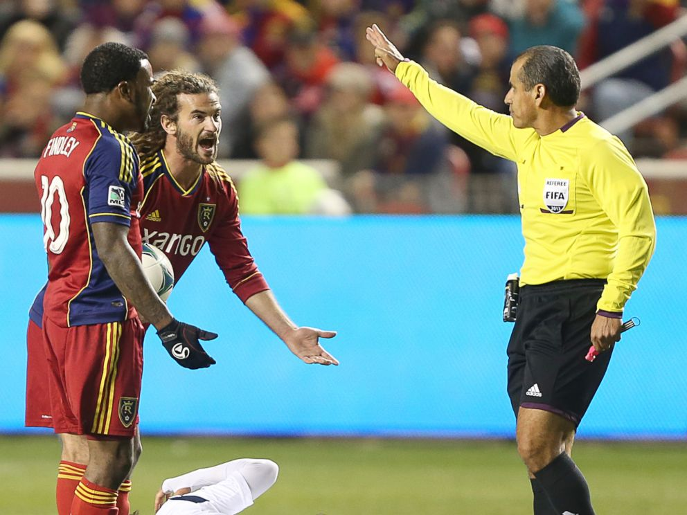 PHOTO: Robbie Findley and Kyle Beckerman of Real Salt Lake argues with an official as Marcelo Sarvas of the Los Angeles Galaxy lies on the ground.
