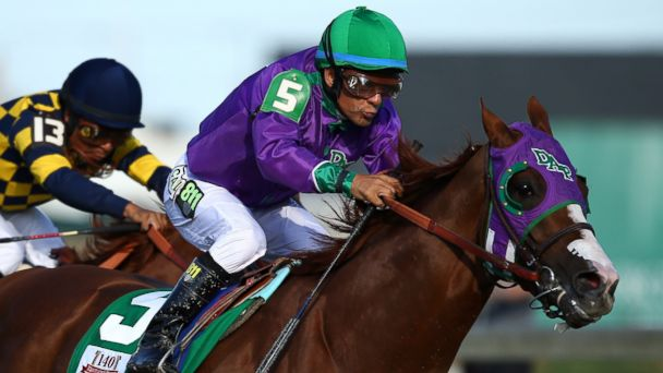 PHOTO: Jockey Victor Espinoza guides California Chrome #5 to the finish line to win the 140th running of the Kentucky Derby at Churchill Downs on May 3, 2014 in Louisville, Kentucky.