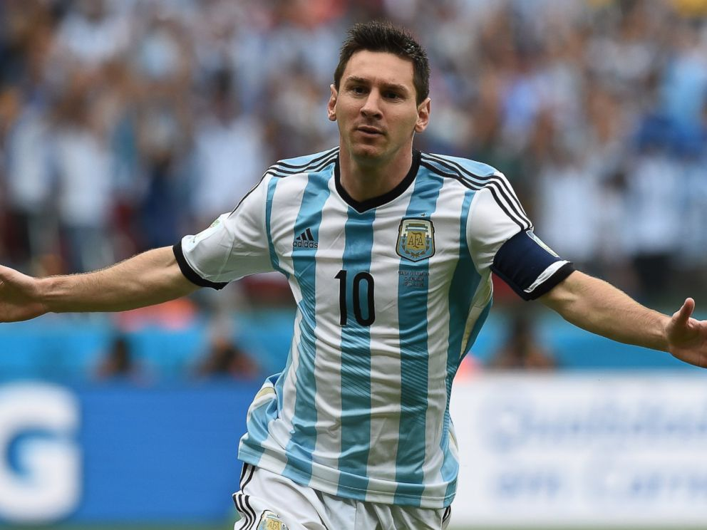 PHOTO: Argentinas forward and captain Lionel Messi celebrates after scoring during the Group F football match between Nigeria and Argentina at the Beira-Rio Stadium in Porto Alegre on June 25, 2014, during the 2014 FIFA World Cup.