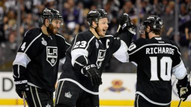 PHOTO: Dustin Brown #23 of the Los Angeles Kings and Mike Richards #10 celebrate Browns double overtime game winner against the New York Rangers on June 7, 2014 in Los Angeles, Calif.