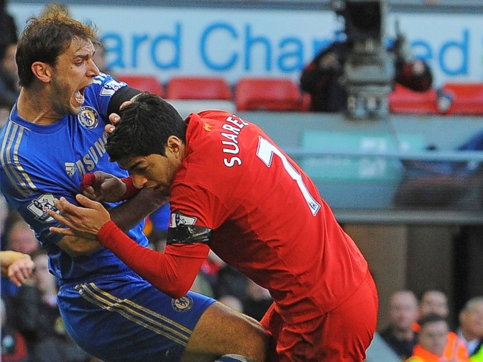 PHOTO: Liverpools Uruguayan striker Luis Suarez, right, clashes with Chelseas Serbian defender Branislav Ivanovic after appearing to bite the Chelsea player during the English Premier League football match.