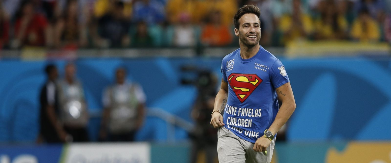 PHOTO: A pitch invader runs on the playing surface during the Round of 16 football match between Belgium and USA at The Fonte Nova Arena in Salvador, July 1, 2014, during the 2014 FIFA World Cup.