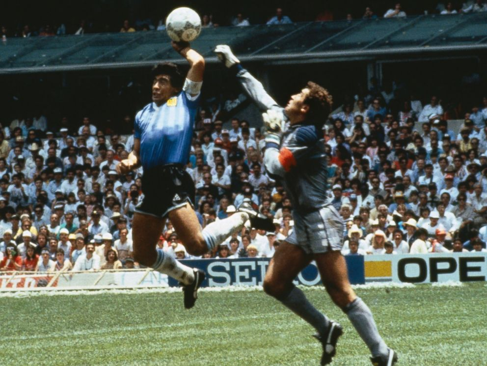 PHOTO: Argentinas Diego Maradona scores with his Hand of God, past England goalkeeper Peter Shilton on June 22, 1986 in Mexico.