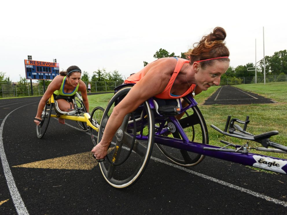 PHOTO: Wheelchair racers Hannah McFadden, left, and sister Tatyana McFadden train together at a local high school in Clarksville, Md, Aug. 21, 2013.