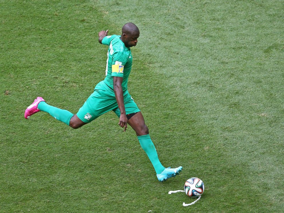 PHOTO: Yaya Toure of the Ivory Coast takes a free kick during the 2014 FIFA World Cup Brazil Group C match between Colombia and Cote DIvoire at Estadio Nacional on June 19, 2014 in Brasilia, Brazil.
