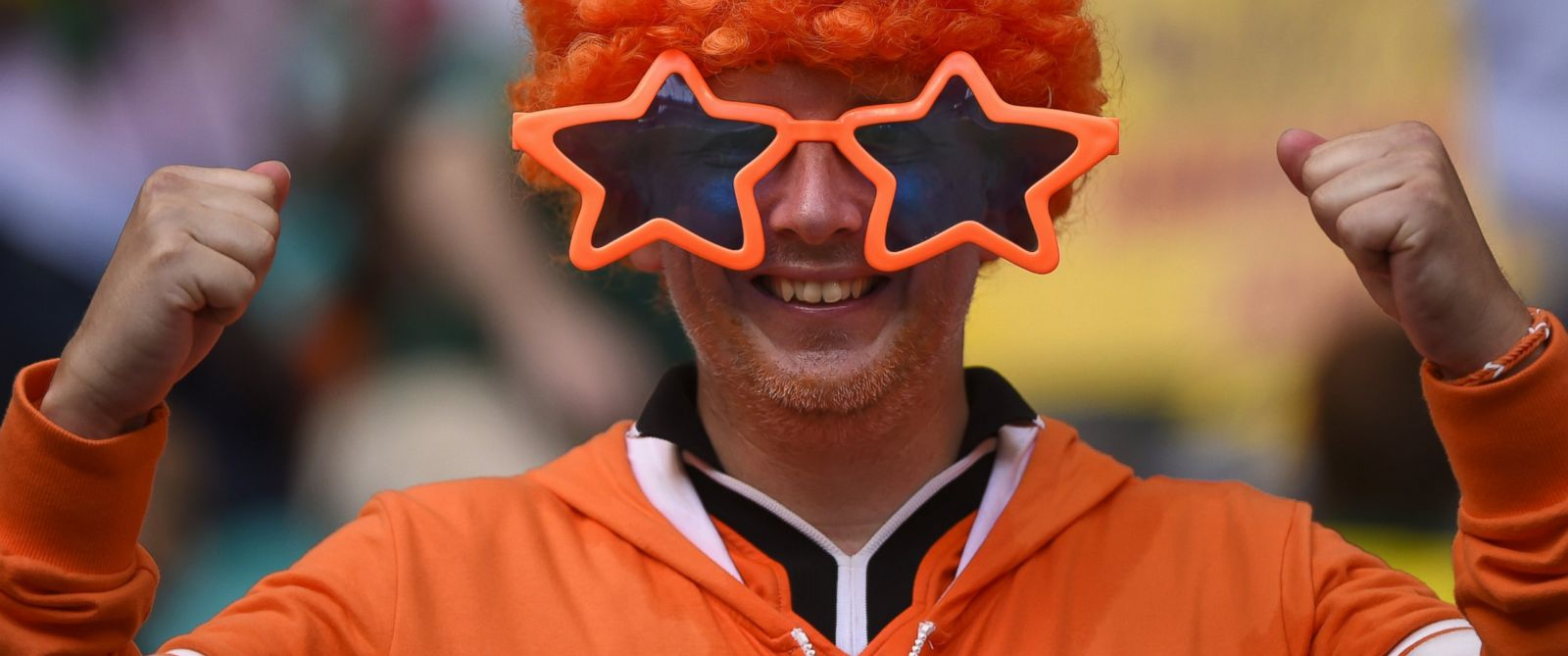 PHOTO: A Netherlands supporter cheers for his team ahead of the quarter-final football match between Netherlands and Costa Rica at the Fonte Nova Arena in Salvador during the 2014 FIFA World Cup on July 5, 2014.