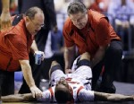 PHOTO: Trainers check on Louisville guard Kevin Ware (5) after Ware injured his lower right leg during the first half of the Midwest Regional final against Duke in the NCAA college basketball tournament, Sunday, March 31, 2013, in Indianapolis.