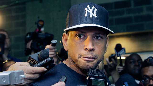 PHOTO: New York Yankees Alex Rodriguez, who is on the disabled list after hip surgery, talks to reporters outside the Yankees clubhouse in New York, April 1, 2013.