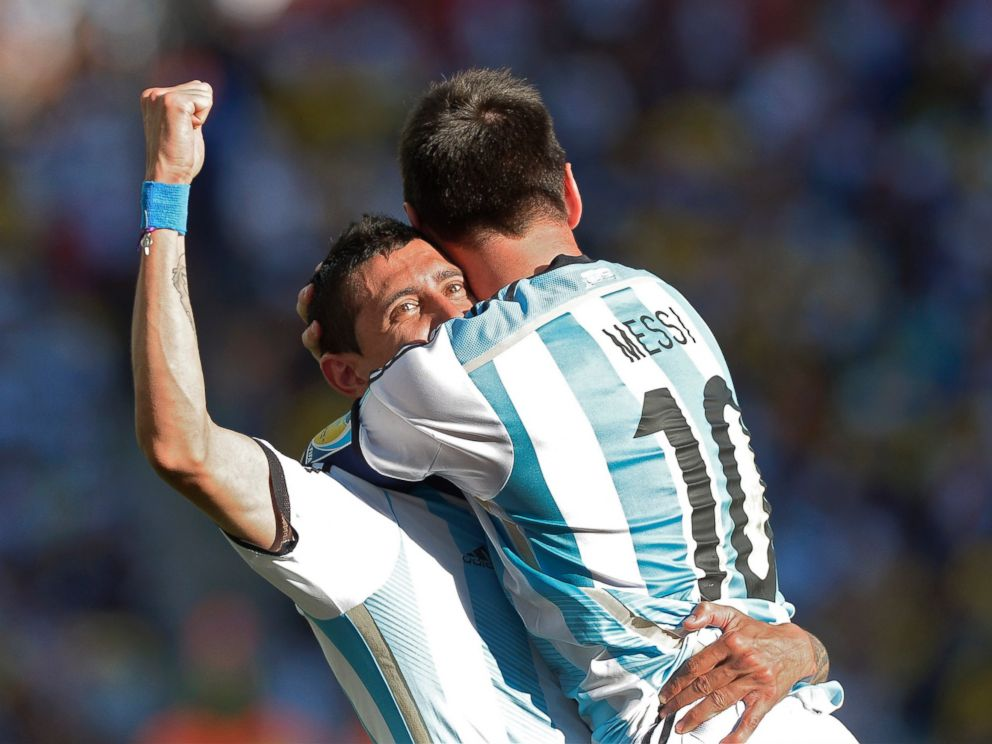 PHOTO: Argentinas Lionel Messi celebrates with Angel di Maria after di Maria scored his sides only and winning goal in extra time during the World Cup match between Argentina and Switzerland at the Itaquerao Stadium in Sao Paulo, Brazil, July 1, 2014.