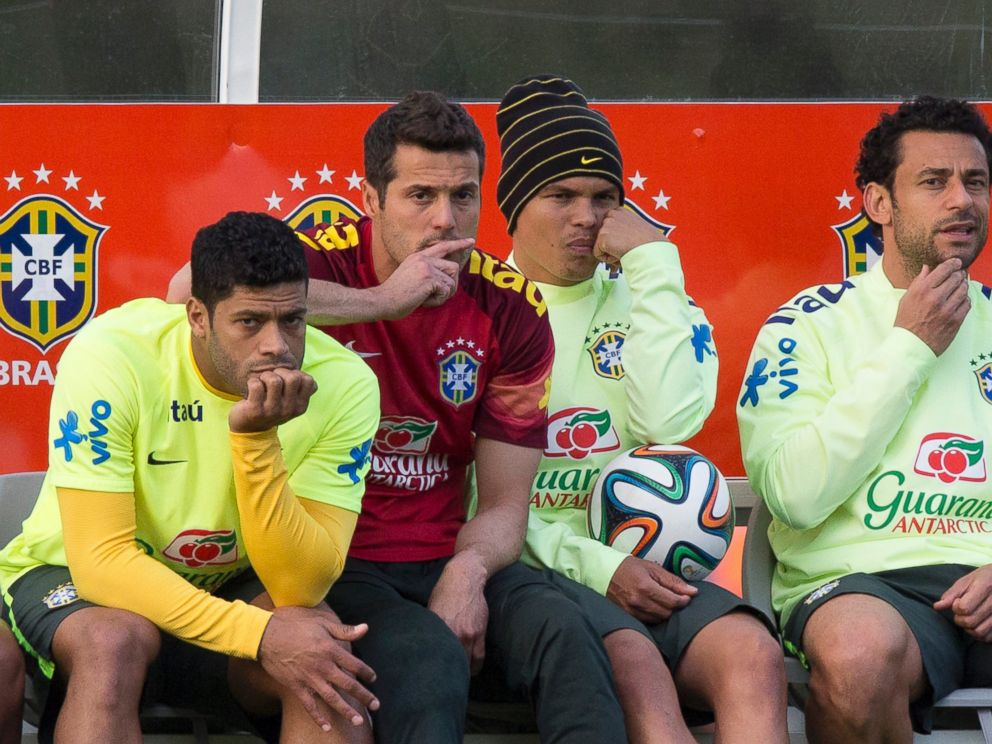 PHOTO: Brazil national soccer team members, from left, Hulk, Julio Cesar, Thiago Silva and Fred, watch other teammates train during a practice session at the Granja Comary training center, in Teresopolis, Brazil, July 6, 2014.