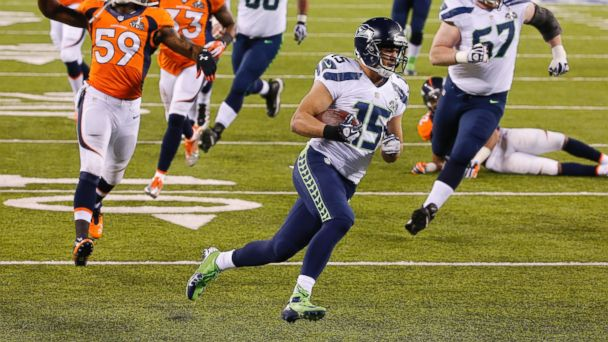 PHOTO: Seattle Seahawks wide receiver Jermaine Kearse (15) breaks free from the Denver Broncos defense on his way to a touchdown during the second half of the NFL Super Bowl XLVIII football game on Feb. 2, 2014, in East Rutherford, N.J.
