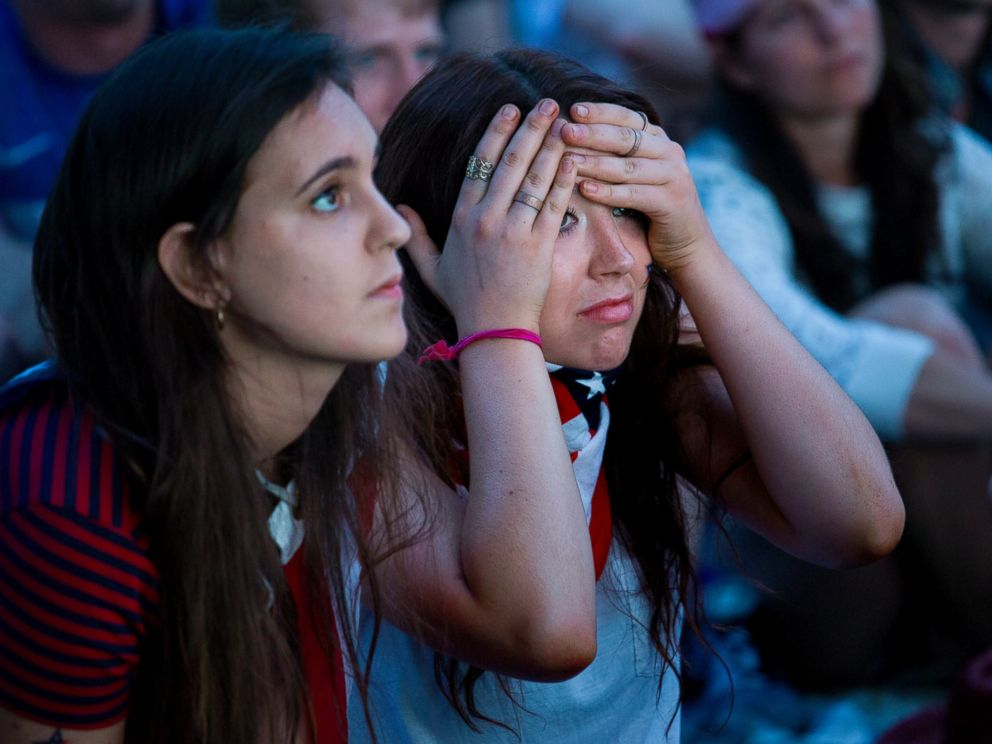 PHOTO: Allison DiFilippo, left, and Samantha Donat, both of New York, react to a last-minute goal that put Portugal even with United States at the end of their 2014 World Cup soccer match, while watching on Governors Island in New York, June 22, 2014.