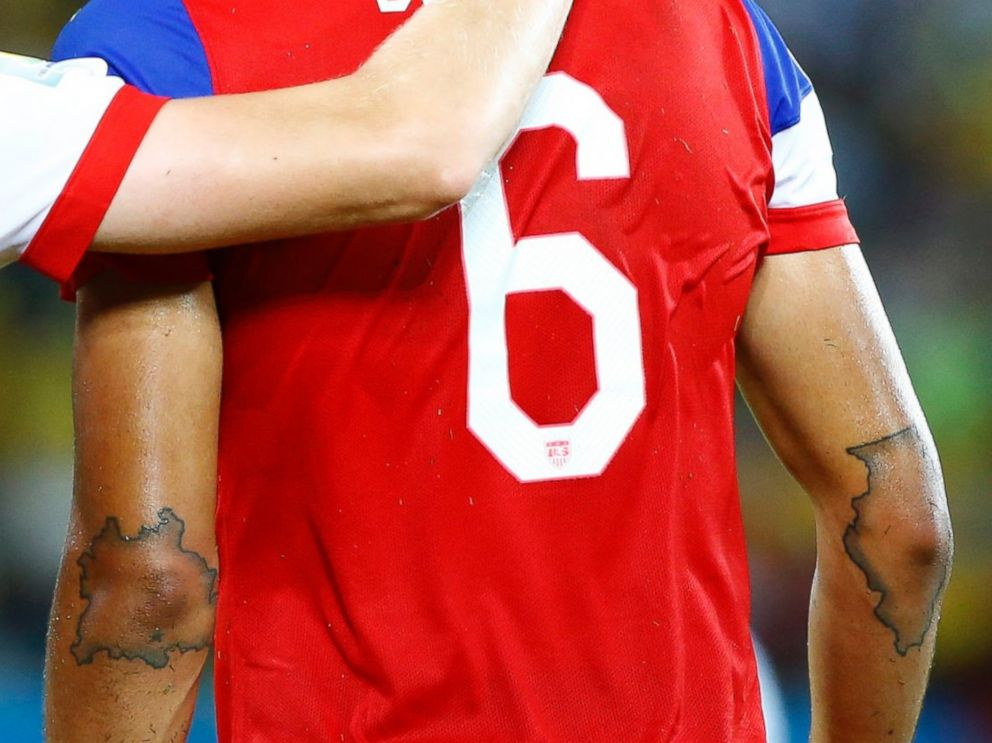 John Brooks has tattoos of the outlines of Germany and Illinois on his elbows, seen here after scoring a goal during their match against Ghana at the Dunas arena in Natal June 16, 2014.