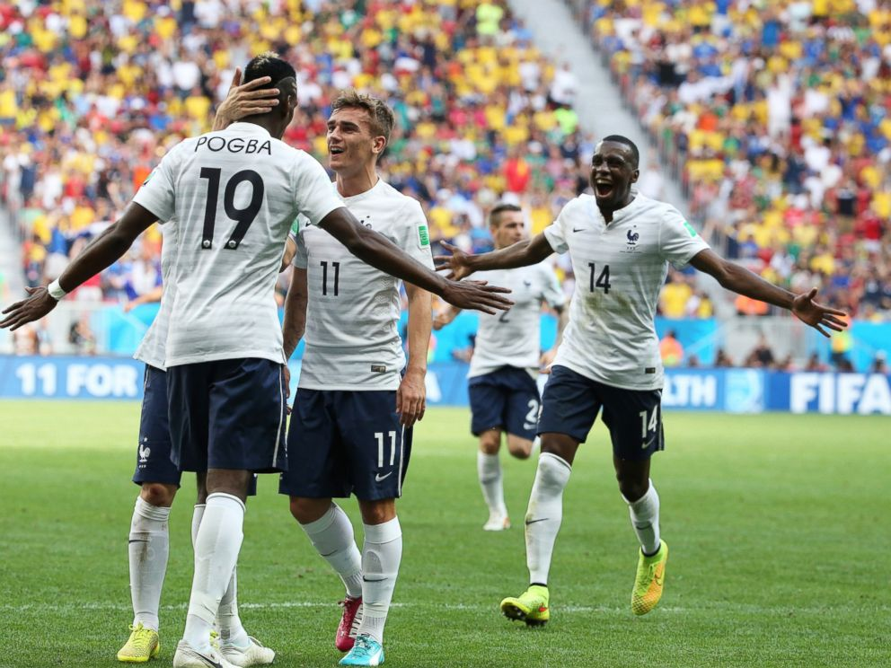 PHOTO: Paul Pogba of France celebrates scoring his teams first goal with his teammates Antoine Griezmann and Blaise Matuidi during the 2014 FIFA World Cup Brazil match between France and Nigeria at Estadio Nacional on June 30, 2014 in Brasilia, Brazil.