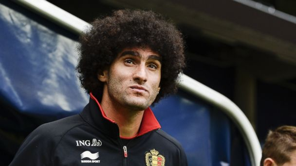 PHOTO: Belgiums midfielder Marouane Fellaini (L) attends a training session at Friends Arena in Solna, near Stockholm on May 31, 2014 on the eve of the friendly match Sweden vs Belgium.