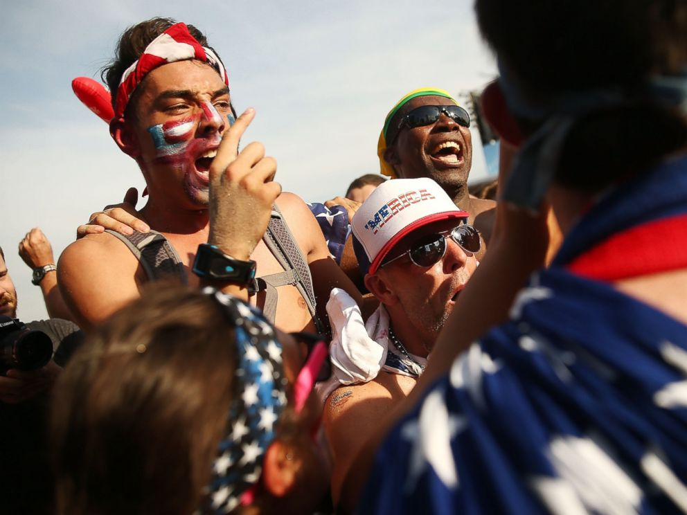 PHOTO: U.S. supporters celebrate advancing to the Round of 16 after their loss to Germany while watching the match at FIFA Fan Fest on June 26, 2014 in Rio de Janeiro, Brazil.