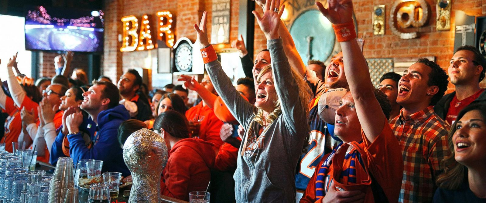 PHOTO: Denver Broncos fans cheer as their team takes the field against the Seattle Seahawks while watching the NFL Super Bowl XLVIII at the View House bar in Denver, Colo. on Feb. 2, 2014.