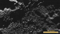 VIDEO: The photos were taken 23 minutes before New Horizons probe approached Pluto.
